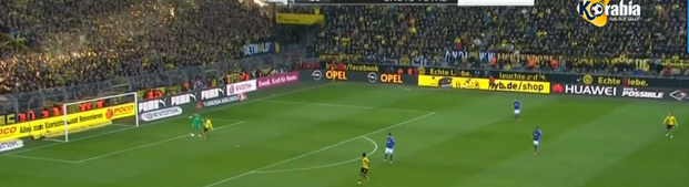 Reus scores the third goal as he wins the ball off Wellenreuther.