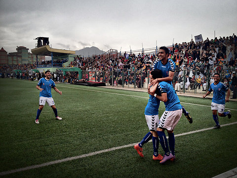 Players from Toofan Harirod celebrated after scoring a goal in the opening minutes of the final match of the Afghan Premier League's first season. Image Source: NY Times