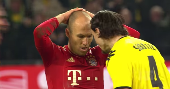 Neven Subotic exchanging a few polite words with Arjen Robben after the latter's penalty miss