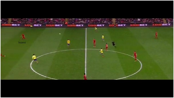 Coutinho lobs a curling aerial ball in the path of Suarez, who is now looking for Sturridge