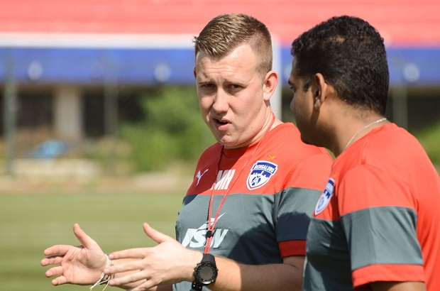 Bengaluru FC's Performance Analyst and Head of Youth Development Matt Holland (L) in conversation with Head of Sports Sciences Donavan Pillai at the Bangalore Football Stadium, in Bengaluru.