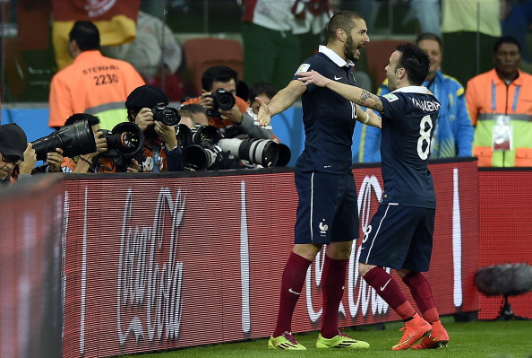 France's forward Karim Benzema (L) celebrates with teammate midfielder Mathieu Valbuena after scoring during the Group E football match between France and Honduras at the Beira-Rio Stadium in Porto Alegre on June 15, 2014, during the 2014 FIFA World Cup. AFP PHOTO / FRANCK FIFE (Photo credit should read FRANCK FIFE/AFP/Getty Images)