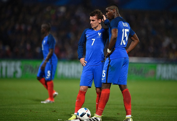 France's forward Antoine Griezmann (L) and France's midfielder Paul Pogba (R) react during the friendly football match between France and Scotland, at the Saint Symphorien Stadium in Metz, eastern France, on June 4, 2016, in preparation of the UEFA Euro 2016. France defeated Scotland 3-0. / AFP / JEAN-CHRISTOPHE VERHAEGEN (Photo credit should read JEAN-CHRISTOPHE VERHAEGEN/AFP/Getty Images)