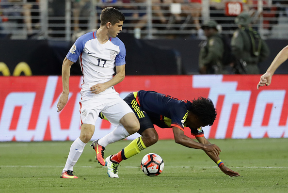 Christian Pulisic #17 of United States collides with Juan Cuadrado #11 of Colombia during the 2016 Copa America Centenario Group match between the United States and Colombia at Levi's Stadium on June 3, 2016 in Santa Clara, California.