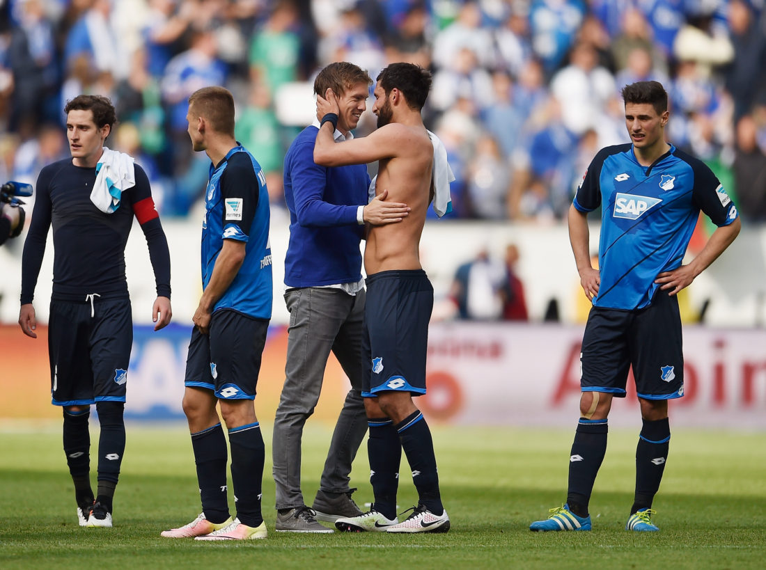 SINSHEIM, GERMANY - MAY 14: Head coach Julian Nagelsmann of 1899 Hoffenheim hugs Kevin Kuranyi after the Bundesliga match between 1899 Hoffenheim and FC Schalke 04 at Wirsol Rhein-Neckar-Arena on May 14, 2016 in Sinsheim, Germany. (Photo by Dennis Grombkowski/Bongarts/Getty Images)