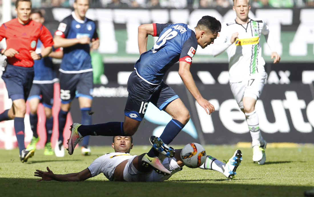 MOENCHENGLADBACH, GERMANY - APRIL 24: Raffael of Moenchengladbach (L) challenges Nadiem Amiri of Hoffenheim during the Bundesliga match between Borussia Moenchengladbach and TSG 1899 Hoffenheim on April 24, 2016 in Moenchengladbach, Germany. (Photo by Mika Volkmann/Bongarts/Getty Images)