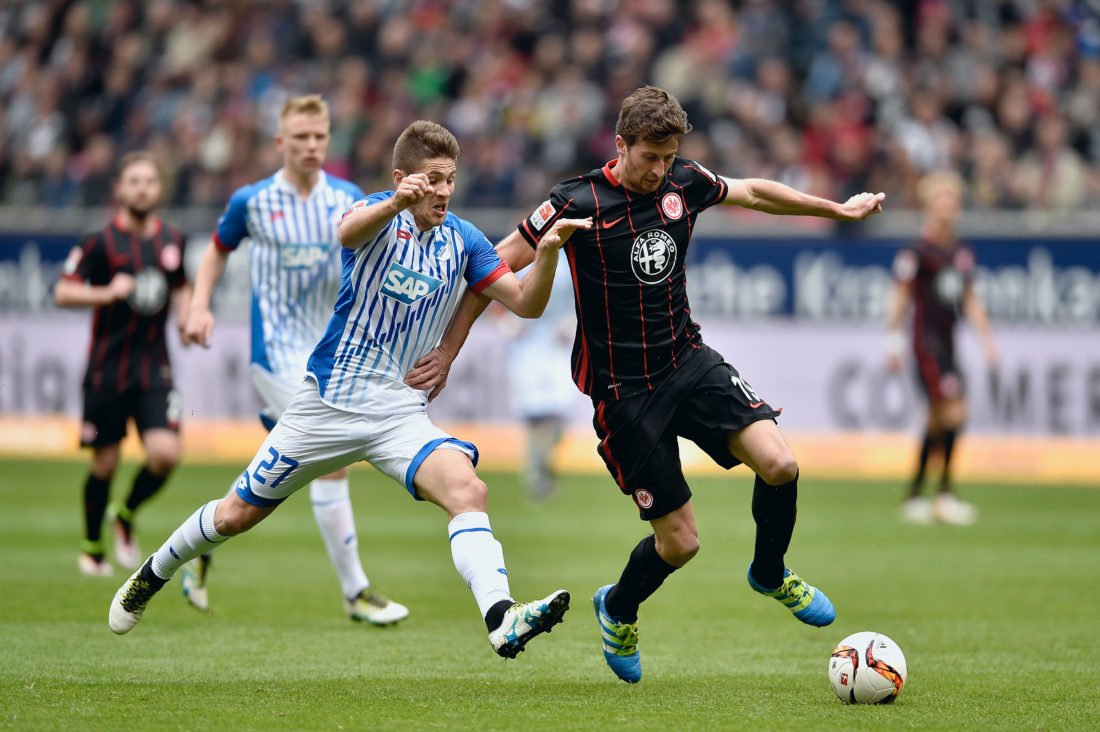 FRANKFURT AM MAIN, HESSE - APRIL 09: Andrej Kramaric of 1899 Hoffenheim and David Abraham of Eintracht Frankfurt battle for the ball during the Bundesliga match between Eintracht Frankfurt and 1899 Hoffenheim at Commerzbank-Arena on April 9, 2016 in Frankfurt am Main, Germany. (Photo by Dennis Grombkowski/Bongarts/Getty Images)