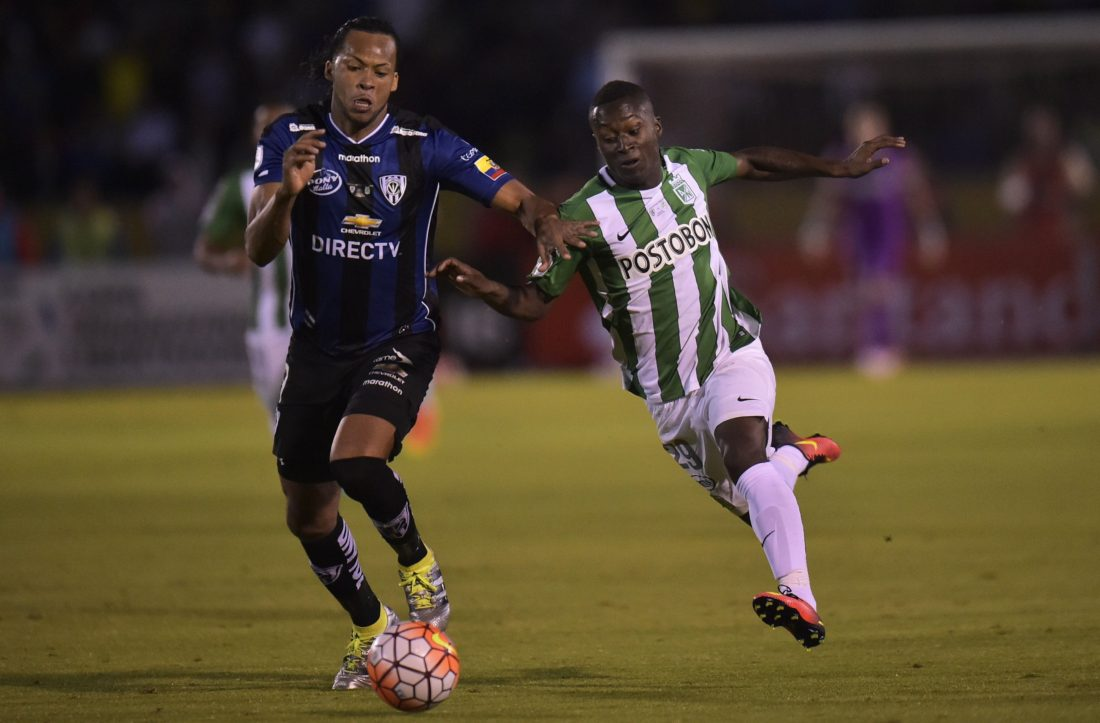 Colombia's Atletico Nacional Marlos Moreno (R) vies for the ball with Ecuador's Independiente del Valle Arturo Mina during the Copa Libertadores first leg football final, at the Atahualpa stadium in Quito on July 20, 2016. / AFP / RODRIGO BUENDIA (Photo credit should read RODRIGO BUENDIA/AFP/Getty Images)