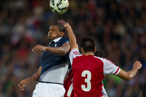 France's forward Sebastien Haller (L) vies with Paraguay's defender Miguel Jacquet (R) during the U-21 friendly football match between France and Paraguay at the Leo Lagrange Stadium in Besancon, eastern France, on June 16, 2015. AFP PHOTO / SEBASTIEN BOZON (Photo credit should read SEBASTIEN BOZON/AFP/Getty Images)