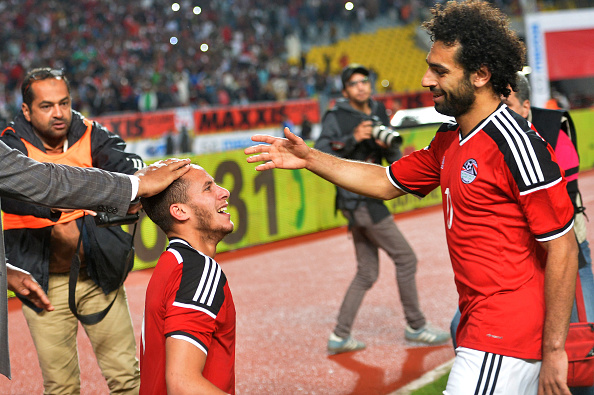 Egypt's Ramadan Sobhi (L) celebrate his goal against Nigeria with his teammate Mohamed Salah (R) during their African Cup of Nations group G qualification football match between Egypt and Nigeria at the Borg el-Arab Stadium in Alexandria on March 29, 2016. / AFP / KHALED DESOUKI (Photo credit should read KHALED DESOUKI/AFP/Getty Images)