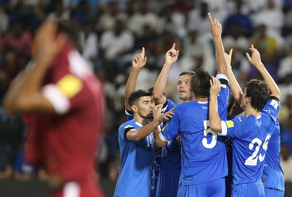 Uzbekistan's players celebrate after scoring a goal during the World Cup 2018 Asia qualification football match between Uzbekistan and Qatar at the Jassim Bin Hamad stadium in Doha on September 6, 2016. Uzbekistan won the match 1-0. / AFP / KARIM JAAFAR (Photo credit should read KARIM JAAFAR/AFP/Getty Images)