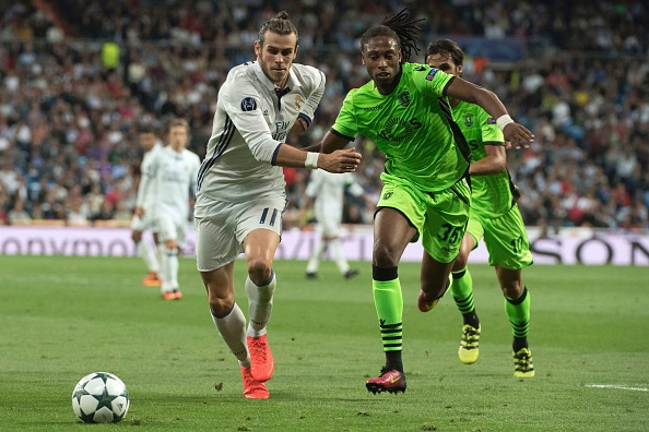 Real Madrid's Welsh forward Gareth Bale (L) vies with Sporting's defender Ruben Semedo during the UEFA Champions League football match Real Madrid CF vs Sporting CP at the Santiago Bernabeu stadium in Madrid on September 14, 2016. / AFP / CURTO DE LA TORRE (Photo credit should read CURTO DE LA TORRE/AFP/Getty Images)