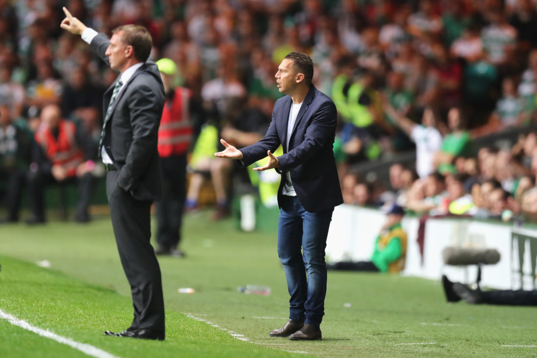 GLASGOW, SCOTLAND - AUGUST 17: Barak Bakhar, coach of Hapoel reacts with Brendan Rodgers, manager of Celtic during the UEFA Champions League Play-off First leg match between Celtic and Hapoel Beer-Sheva at Celtic Park on August 17, 2016 in Glasgow, Scotland. (Photo by Steve Welsh/Getty Images)