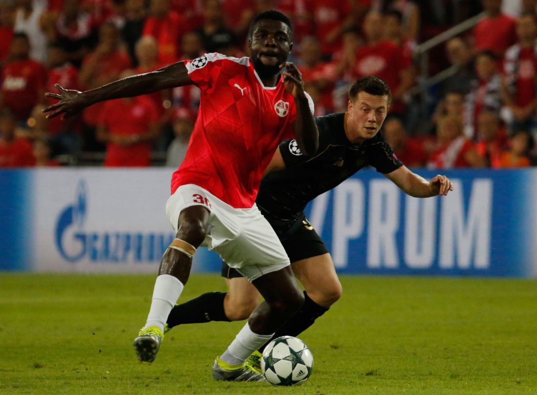 Hapoel's John Ogu tries to control the ball as Celtic's James Forest (back) defends during the UEFA Champions League group stages play-off football match between Celtic and Hapoel Beer Sheva at the Turner Stadium in the southern Israeli city of Beer Sheva on August 23, 2016. The game is being played in the most southerly stadium in European competition history, UEFA confirmed. / AFP / GIL COHEN-MAGEN (Photo credit should read GIL COHEN-MAGEN/AFP/Getty Images)