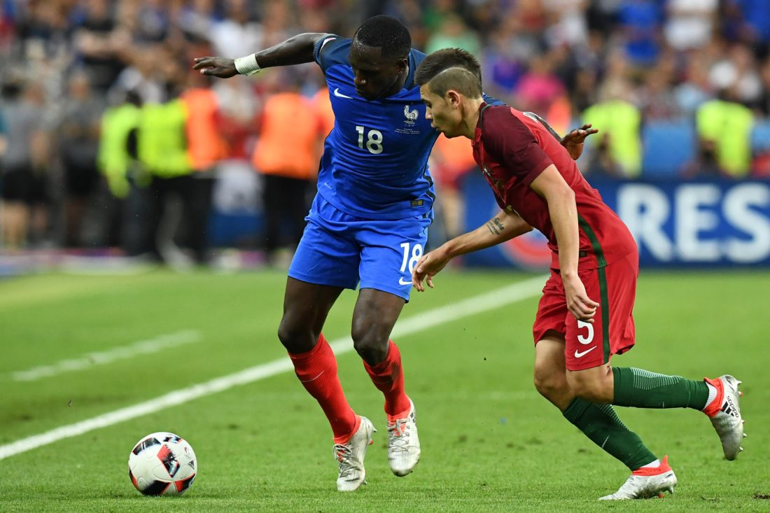 France's midfielder Moussa Sissoko (L) vies for the ball against Portugal's defender Raphael Guerreiro during the Euro 2016 final football match between France and Portugal at the Stade de France in Saint-Denis, north of Paris, on July 10, 2016. / AFP / FRANCK FIFE (Photo credit should read FRANCK FIFE/AFP/Getty Images)