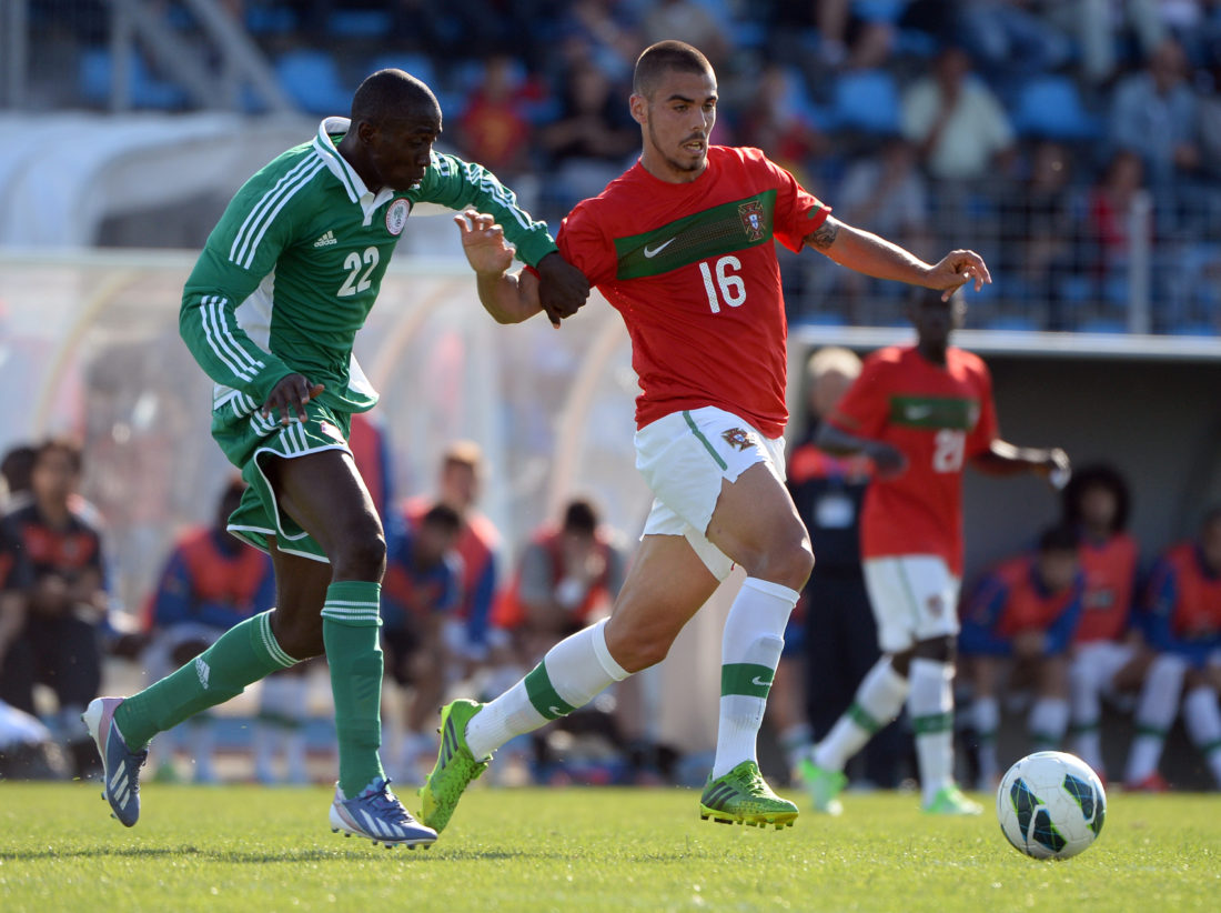 "Nigeria's Onyinye Ndidi (L) vies with Portugal's Alves (R) during their Under 21 international football match Nigeria vs. Portugal, at the Leo Lagrange Stadium in Toulon, southern France on June 6, 2013, as part of the ""World Youth Festival Toulon"". AFP PHOTO / ANNE-CHRISTINE POUJOULAT (Photo credit should read ANNE-CHRISTINE POUJOULAT/AFP/Getty Images)"