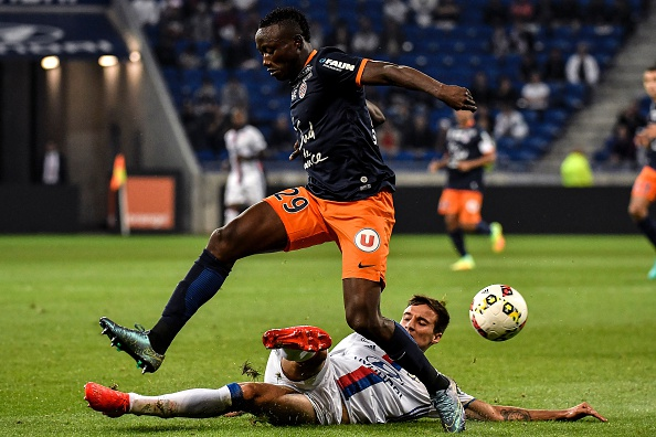 Emanuel Mammana winning one of his ten successful tackles against Montpellier | Jeff Pachoud / AFP /Getty Images