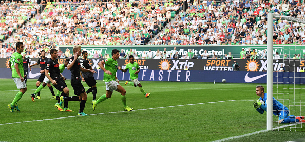 Sven Muller saves a shot from Mario Gomez in his Bundesliga debut. Stuart Franklin / Bongarts / Getty Images