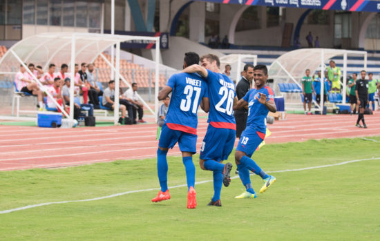 CK Vineeth celebrates his opener against Tampines Rovers with Cameron Watson and Rino Anto in the AFC Cup quarterfinal first leg at the Kanteerava Stadium, in Bengaluru, on Wednesday.