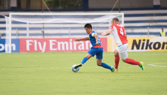 Bengaluru FC skipper Sunil Chhetri looks to get away from Tampines Rovers' Mustafic Fahrudin during the AFC Cup quarterfinal first leg at the Kanteerava Stadium, in Bengaluru, on Wednesday.