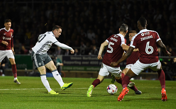 NORTHAMPTON, ENGLAND - SEPTEMBER 21: Wayne Rooney of Manchester United shoots on goal during the EFL Cup Third Round match between Northampton Town and Manchester United at Sixfields on September 21, 2016 in Northampton, England. (Photo by Shaun Botterill/Getty Images)