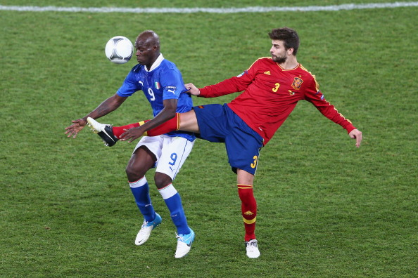 KIEV, UKRAINE - JULY 01: Mario Balotelli (L) of Italy and Gerard Pique of Spain battle for the ball during the UEFA EURO 2012 final match between Spain and Italy at the Olympic Stadium on July 1, 2012 in Kiev, Ukraine. (Photo by Michael Steele/Getty Images)