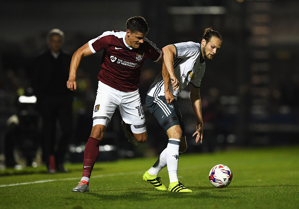 NORTHAMPTON, ENGLAND - SEPTEMBER 21: Alex Revell of Northampton Town and Daley Blind of Manchester United in action during the EFL Cup Third Round match between Northampton Town and Manchester United at Sixfields on September 21, 2016 in Northampton, England. (Photo by Laurence Griffiths/Getty Images)