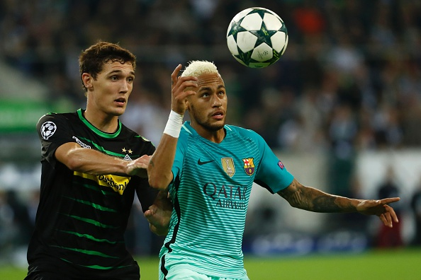 Barcelona's Brazilian forward Neymar (R) and Moenchengladbach's Danish defender Andreas Christensen vie for the ball during the UEFA Champions League first-leg group C football match between Borussia Moenchengladbach and FC Barcelona at the Borussia Park in Moenchengladbach, western Germany on September 28, 2016. / AFP / Odd ANDERSEN (Photo credit should read ODD ANDERSEN/AFP/Getty Images)