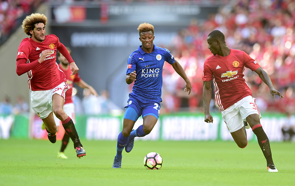LONDON, ENGLAND - AUGUST 07: Demarai Gray of Leicester City skip past Eric Bailly of Manchester United and Marouane Fellaini of Manchester United during The FA Community Shield match between Leicester City and Manchester United at Wembley Stadium on August 7, 2016 in London, England. (Photo by Alex Broadway/Getty Images)