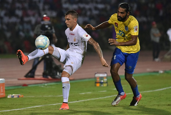 Northeast United FC's forward Nicolas Velez (L) tries to control the ball as Kerala Blasters FC's defender Sandesh Jhingan challenges during the Indian Super League (ISL) football match between Northeast United FC and Kerala Blasters FC at The Indira Gandhi Athletic Stadium in Guwahati on October 1, 2016. / AFP / Biju BORO
