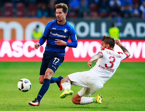AUGSBURG, GERMANY - SEPTEMBER 24: Sandro Sirigu of SV Darmstadt 98 is challenged by Kostas Stafylidis of Augsburg during the Bundesliga match between FC Augsburg and SV Darmstadt 98 at WWK Arena on September 24, 2016 in Augsburg, Germany. (Photo by Adam Pretty/Bongarts/Getty Images)