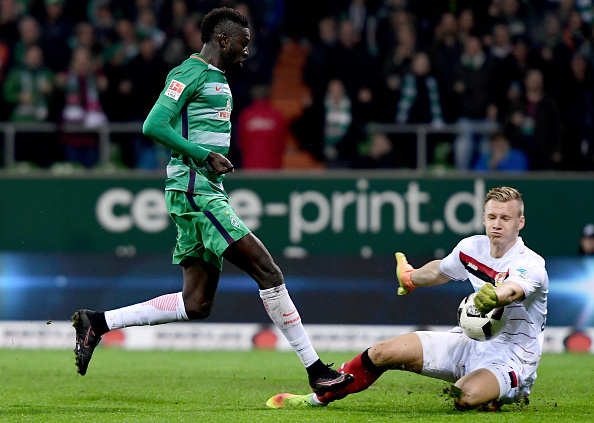 BREMEN, GERMANY - OCTOBER 15: Ousman Manneh (L) of Bremen fails to score over Bernd Leno, goalkeeper (R) of Leverkusen during the Bundesliga match between Werder Bremen and Bayer 04 Leverkusen at Weserstadion on October 15, 2016 in Bremen, Germany. (Photo by Stuart Franklin/Bongarts/Getty Images)