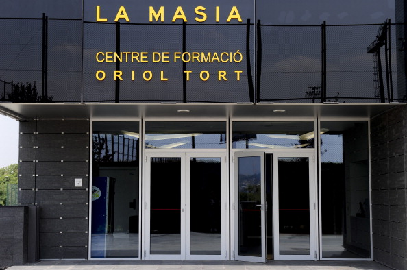 "Entry of the new building named ""La Masia"" of the training centre Oriol Tort where young players of the Barcelona football club live and train, near the Camp Nou stadium in Barcelona on August 5, 2011 . AFP PHOTO/ JOSEP LAGO"