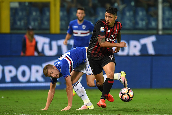 GENOA, ITALY - SEPTEMBER 16: Milan Skriniar (L) of UC Sampdoria is tackled by Gianluca Lapadula of AC Milan during the Serie A match between UC Sampdoria and AC Milan at Stadio Luigi Ferraris on September 16, 2016 in Genoa, Italy. (Photo by Valerio Pennicino/Getty Images)