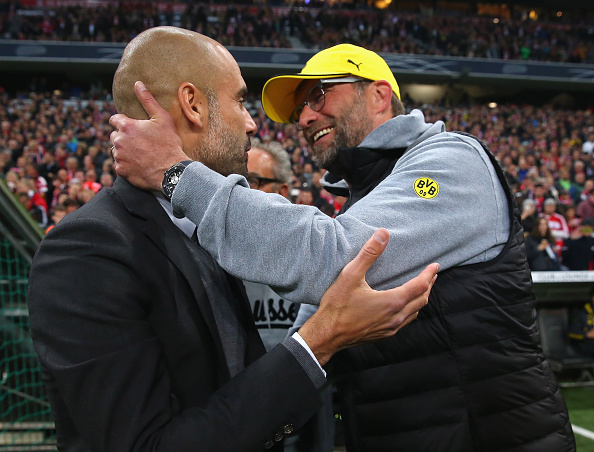 MUNICH, GERMANY - APRIL 28: Josep Guardiola, head coach of Bayern Muenche greets Juergen Klopp head coach of Dortmund at the start of the DFB Cup semi final match between FC Bayern Muenchen and Borussia Dortmund at Allianz Arena on April 28, 2015 in Munich, Germany. (Photo by Alexander Hassenstein/Bongarts/Getty Images)