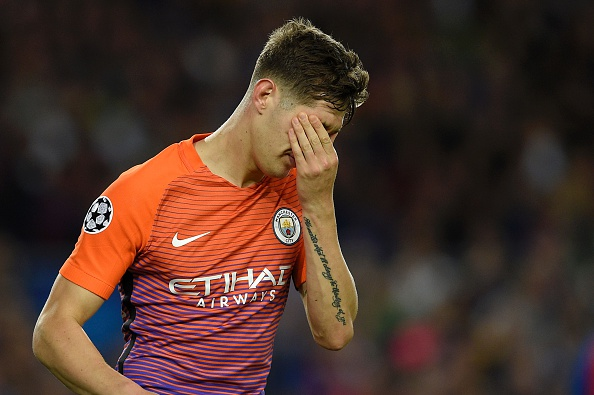 Manchester City's defender John Stones gestures during the UEFA Champions League football match FC Barcelona vs Manchester City at the Camp Nou stadium in Barcelona on October 19, 2016. / AFP / LLUIS GENE (Photo credit should read LLUIS GENE/AFP/Getty Images)