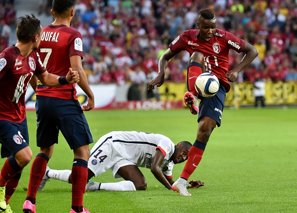 Lille's french midfielder Soualiho Meite (R) vies with Paris Saint-Germain's midfielder Blaise Matuidi during the French L1 football match between Lille and PSG on August 7, 2015 at the Pierre Mauroy Stadium in Villeneuve d'Ascq. AFP PHOTO / PHILIPPE HUGUEN (Photo credit should read PHILIPPE HUGUEN/AFP/Getty Images)