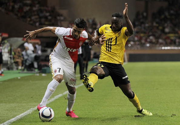 Lille's French midfielder Soualiho Meite (R) vies with Monaco's Moroccan midfielder Nabil Dirar (L) during the French L1 football match Monaco (ASM) against Lille (LOSC) on August 14, 2015, at the Louis II Stadium in Monaco. Monaco and Lille tied 0-0. AFP PHOTO / JEAN CHRISTOPHE MAGNENET (Photo credit should read JEAN CHRISTOPHE MAGNENET/AFP/Getty Images)