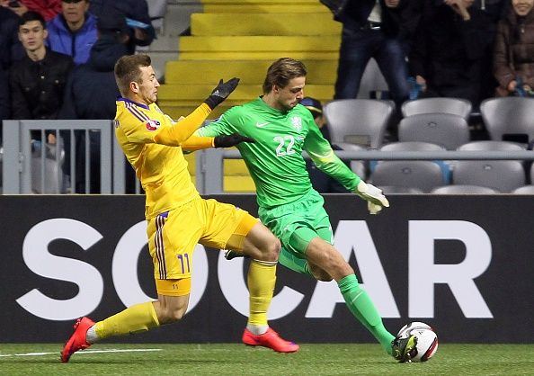 Kazakhstan's Aleksei Schetkin (L) vies for the ball with Dutch goalkeeper Tim Krul (R) during the Euro 2016 Group A qualifying football match between Kazakhstan and the Netherlands in Astana on October 10, 2015. AFP PHOTO / STANISLAV FILIPPOV (Photo credit should read STANISLAV FILIPPOV/AFP/Getty Images)