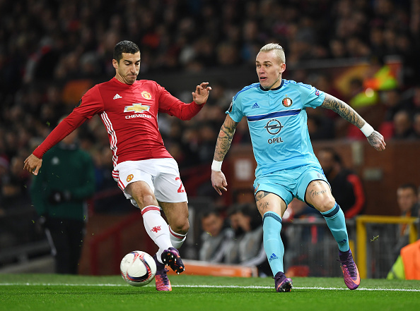 MANCHESTER, ENGLAND - NOVEMBER 24: Henrikh Mkhitaryan of Manchester United and Rick Karsdorp of Feyenoord battle for the ball during the UEFA Europa League Group A match between Manchester United FC and Feyenoord at Old Trafford on November 24, 2016 in Manchester, England. (Photo by Gareth Copley/Getty Images)