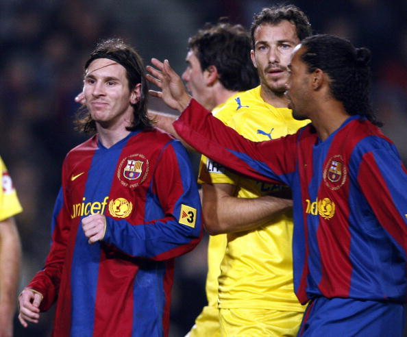 FC Barcelona's Brazilian player Ronaldinho (R) gestures to teammate Leo Messi (L) after missing a penalty during a Spanish King's Cup championship football match at the Camp Nou in Barcelona 31 January 2008. AFP PHOTO/LLUIS GENE. (Photo credit should read LLUIS GENE/AFP/Getty Images)